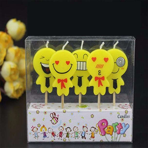 A packet of 5 Emoji Cake Candles