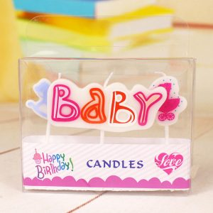 A packet of three baby shower candles in pink, red and baby blue.